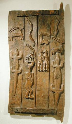 A box lid with carved animal reliefs, from Mali