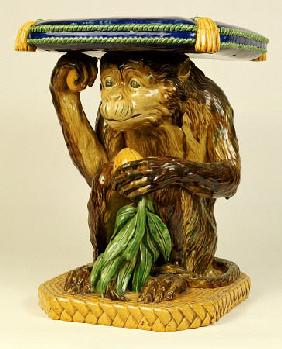 A Minton ''Majolica'' Garden Seat Modelled As A Crouching Monkey Supporting A Cushion On His Head, C