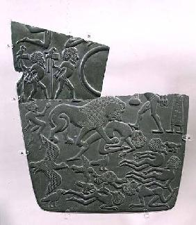 The Battlefield Palette, depicting captives and slain victims of battle, the latter preyed upon by w c.3100 BC