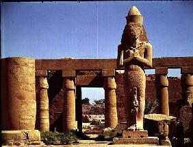 The Colossus of Ramesses II: standing statue of the king with his daughter Benta anta in front of hi c.1320-120