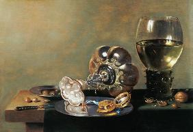 A still life with glass of wine, tazza and a pewter plate 17th