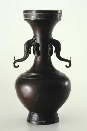 Vase with elephant head handles