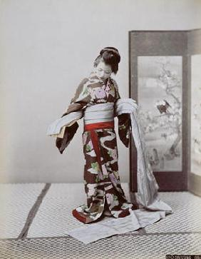 Young Japanese Girl Dressing, late 19th century (hand coloured photo) 19th