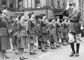 General Charles de Gaulle during review of young women of Free French Forces at Wellington barracks  July 14, 1