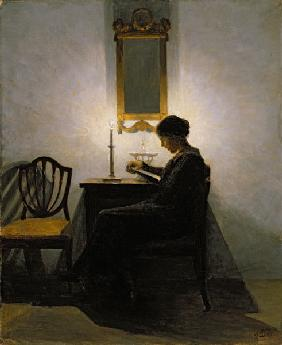 Woman reading by candlelight 1908